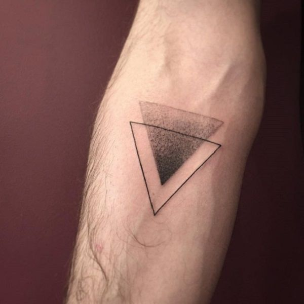 A double Triangle Glyph Tattoo design. A simple looking yet beautiful glyph symbol where one triangle is a thin outline and the other is a gradient form. Each going together side by side and completing the very minimalist inspired design.