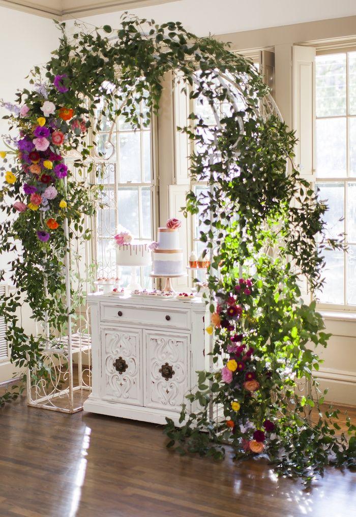 floral garden arch dessert spread from a secret garden baby shower on
