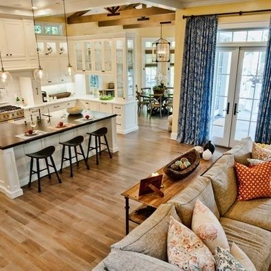 Love this open floor plan, white kitchen, wood floors, black matte counters, breakfast nook on NE side overlooking pasture and chickens. @larisanilow7