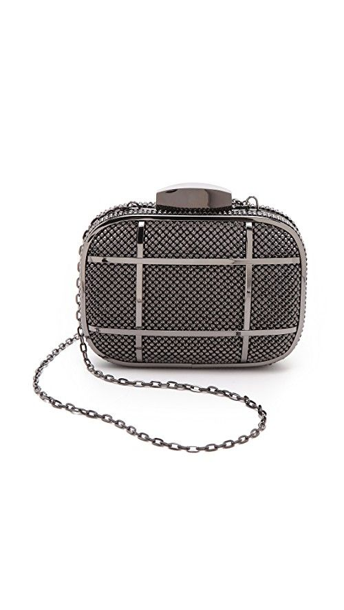 Whiting & Davis Cage Minaudiere Clutch | Studded metal mesh lends a hit of rock-n-roll attitude to a petite minaudiere. Glossy bands add a graphic edge, and the top opens with a sleek push lock. The chain strap tucks inside the logo-lined interior when not in use. Weight: 12oz / 0.34kg. Imported, China. MEASUREMENTS Height: 4in / 10cm Length: 6in / 15cm Depth: 1.5in / 4cm Strap drop: 21in / 53.5cm