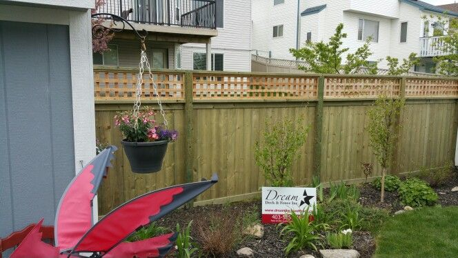 6 foot high Bastion Estate style fence with 4x6 posts and 16 inches of cedar 1x1 lattice on top.....www.dreamdeckandfence.ca