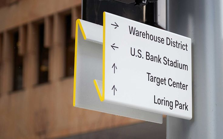 Graphic identity, signage and wayfinding by Pentagram's Paula Scher and team for Nicolett in Minneapolis