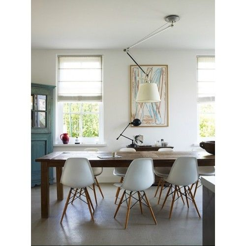 Contemporary white chairs with beech wood legs