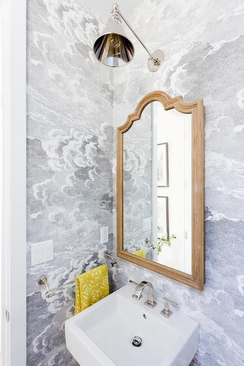 Great A Polished Nickel Swing Arm Sconce Is Mounted To A Wall Clad In Fornasetti  Nuvole Wallpaper