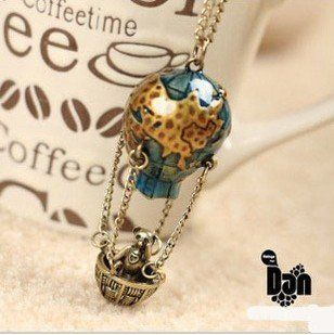 Vintage-style teddy bear in a hot air balloon necklace.