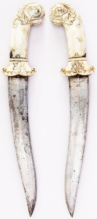 Indian khanjar, 19th century, steel, jade, H. 14 in. (35.6 cm); H. of blade 9 1/4 in. (23.5 cm); W. 2 11/16 in. (6.8 cm); Wt. 10.2 oz. (289.2 g), Met Museum, Bequest of George C. Stone, 1935.
