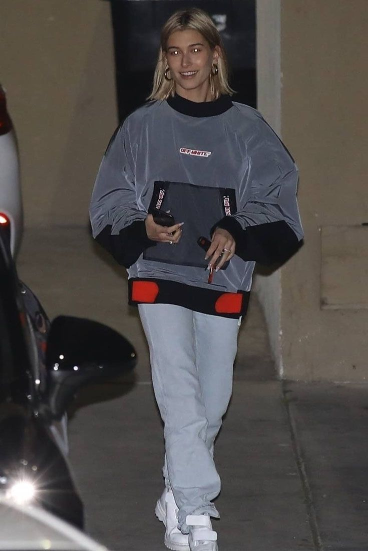 Hailey Baldwin wears an Off White shirt and Dr. Martens