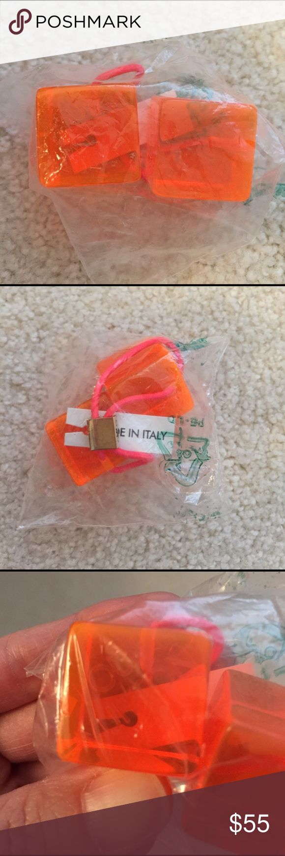 100% Authentic Louis Vuitton Hair Cube 100% Authentic Louis Vuitton Hair Cube Florescent Orange with Bright Pink Elastic, Gold Hardware. BRAND NEW! Still in original package, never opened. 1 hair Cube only. No box, no bag, as is. Hard to see but does have the Louis Vuitton Logo on the cube as well. Louis Vuitton Accessories