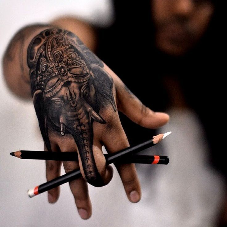 Elephant tattoo - amazing idea for a hand tattoo!