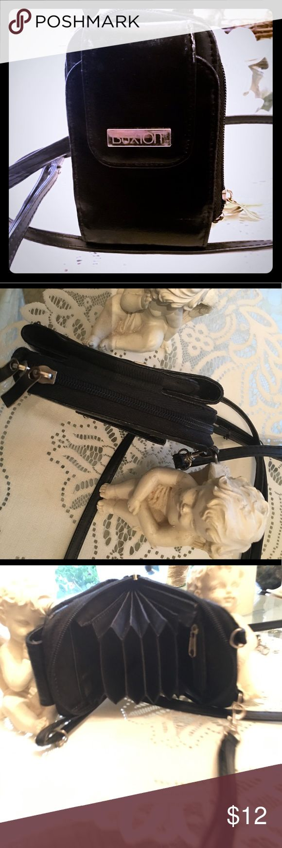 LADIES CROSS BODY STRAP BUXTON OR WRISTLET WALLET Cute and organized - BUXTON wallet great condition- has the wristlet strap and a strap for cross body - this is a great wallet ! Good condition Buxton Accessories