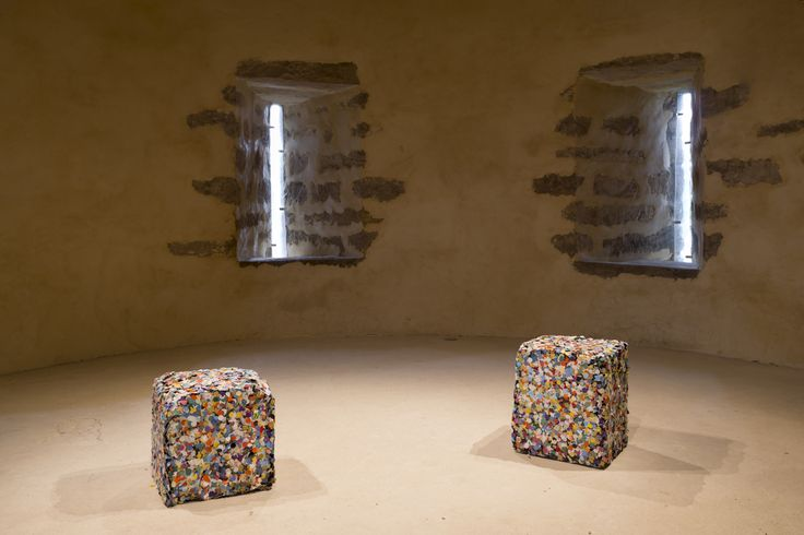 Nari Ward, Mission Accomplished I & II, 2013 90-80 kg metal cubes, confetti. View at Castle of Blandy, 2013. Photo by: Oak Taylor-Smith.