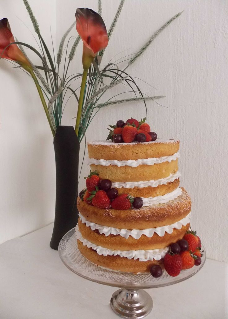 """Naked"" wedding cake with fresh strawberries"