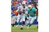 Buffalo Bills quarterback EJ Manuel (3) is pressured by Miami Dolphins defensive tackle Jared Odrick... - (AP Photo/Bill Wippert