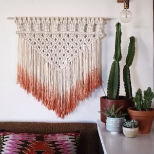 """This intricately woven wall hanging is a texture and color two for one! Use it to spruce up any room. Dimensions: Small measures 12"""" x 16"""". Medium measures 24"""" x 28"""" and Large measures 36"""" x 40"""" Detai"""