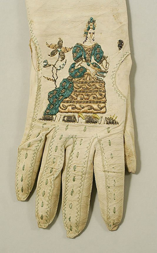White learher glove, lined with silk, embroidered with a gowned lady. British, circa 1600s (17th century)