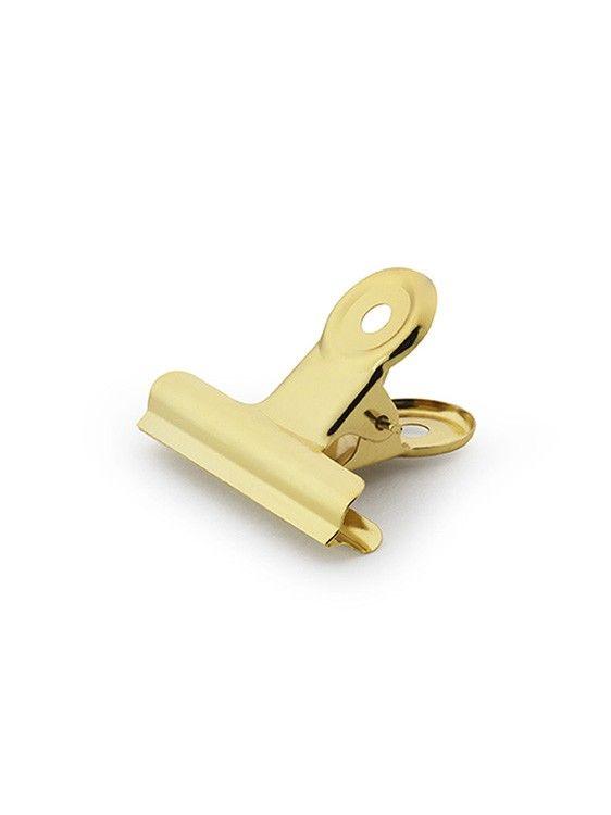 Office, en guldfärgad klämma i smart design från House Doctor. Trendig dansk design.