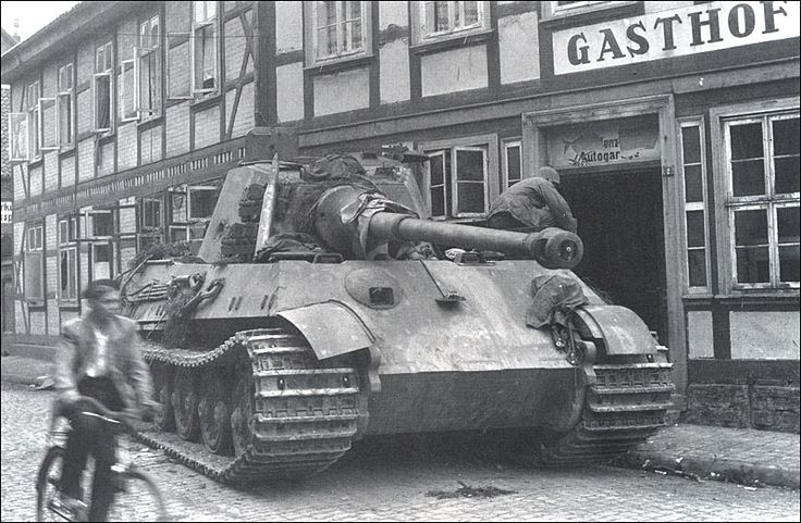 Tiger II, s.PzAbt. 507, abandoned - March 1945.  Note the massive, 150 mm inclined at 50° glacis plate.Like all German tanks, it had a gasoline engine; in this case the same 700 PS (690 hp, 515 kW) V-12 Maybach HL 230 P30 which powered the much lighter Panther and Tiger I tanks. The Tiger II was under-powered, like many other heavy tanks of World War II, and consumed a lot of fuel, which was in short supply for the Germans.