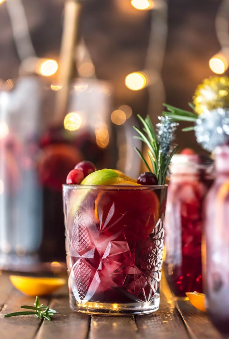 EASY HOLIDAY SANGRIA (GLUTEN FREE!) is the perfect Christmas cocktail! Made with red wine, vodka, sparkling apple cider, and several juices; you'll be the star of any holiday party. Cheers!