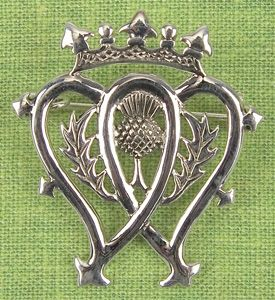 Luckenbooth Brooches from Edinburgh, Scotland (in the 1700's) were traditionally exchanged between lovers on betrothal. Features two intertwined hearts - Scotland's Thistle and Mary Queen of Scot's crown. <> (Scottish, celtic, celts, jewelry)