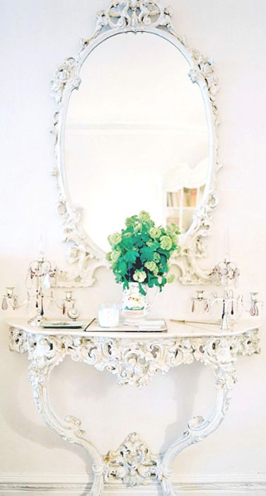Carved hall table and mirror.