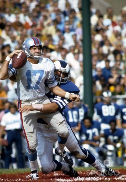 Jul 31, 1971. Houston Oilers quarterback Jerry Rhome (17) is tackled by Los Angeles Rams defensive tackle Phil Olsen