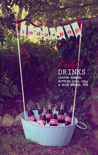 mini glass bottles of Coke with soda fountain type striped paper straws.