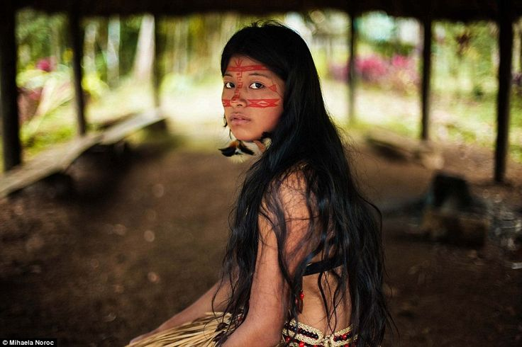 In the jungle: Wearing face paint, this Kichwa woman in the Amazon rainforest is now part ...