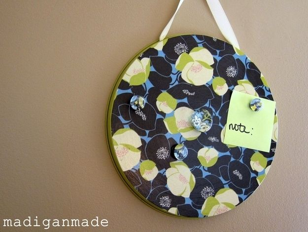 Make a little magnet board with a burner cover.   31 Cheap And Brilliant Dollar Store Hacks