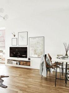 Scandinavian Style Living Room With TV Hanging Over Floating Shelf