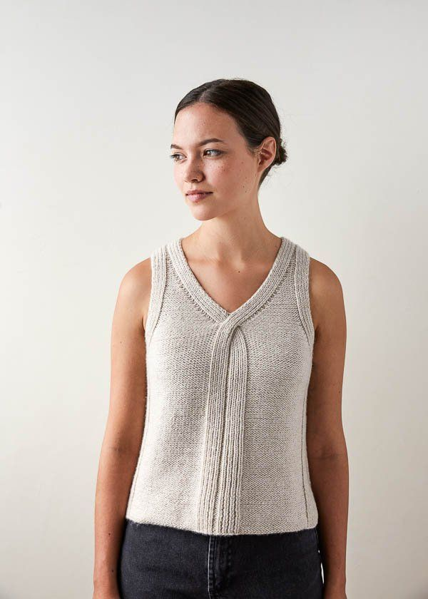 c225e9667c4bcf I am loving the Criss Cross Top knitting pattern from Purl Soho. Designed  by Adam Aronowitz, it's worked from the bottom up, with a little opening in  the ...