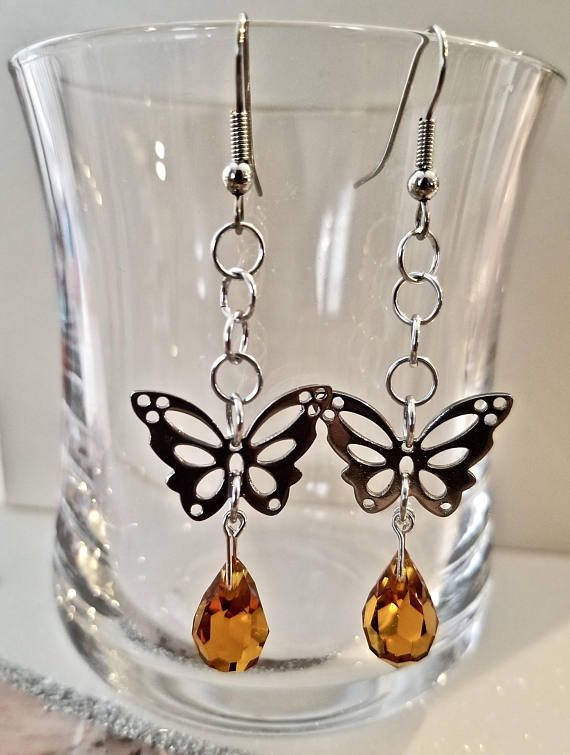 Butterflies are fascinating and beautiful creatures and I love them. That is why I created these beautiful butterfly earrings featuring an orange Preciosa crystal. For those of you who love butterflies these earrings are for you.