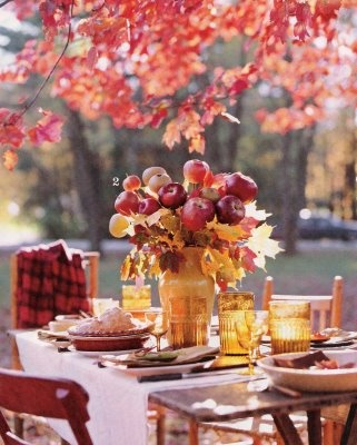 Apples on sticks with branches of fall leaves! (photo is from Country Home Oct. 2007