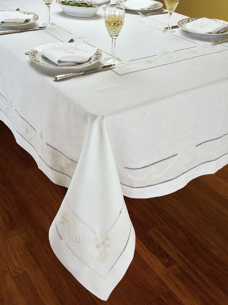 Manor - Luxury Table Cloths - Because the fine art of subtlety is always de rigueur, White 100% linen woven in Italy, is exquisitely hand-embroidered with graceful sprays of Ivory flowers