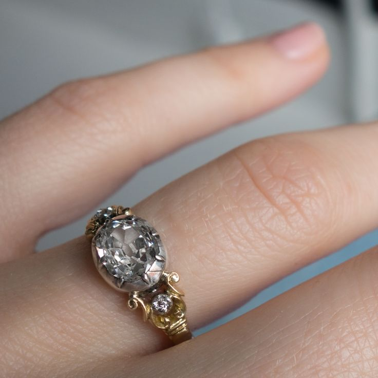 Antique Georgian engagement ring made in 18k yellow gold and silver. Centered with an approximately .85 carat old mine cushion cut diamond. Circa 1830.