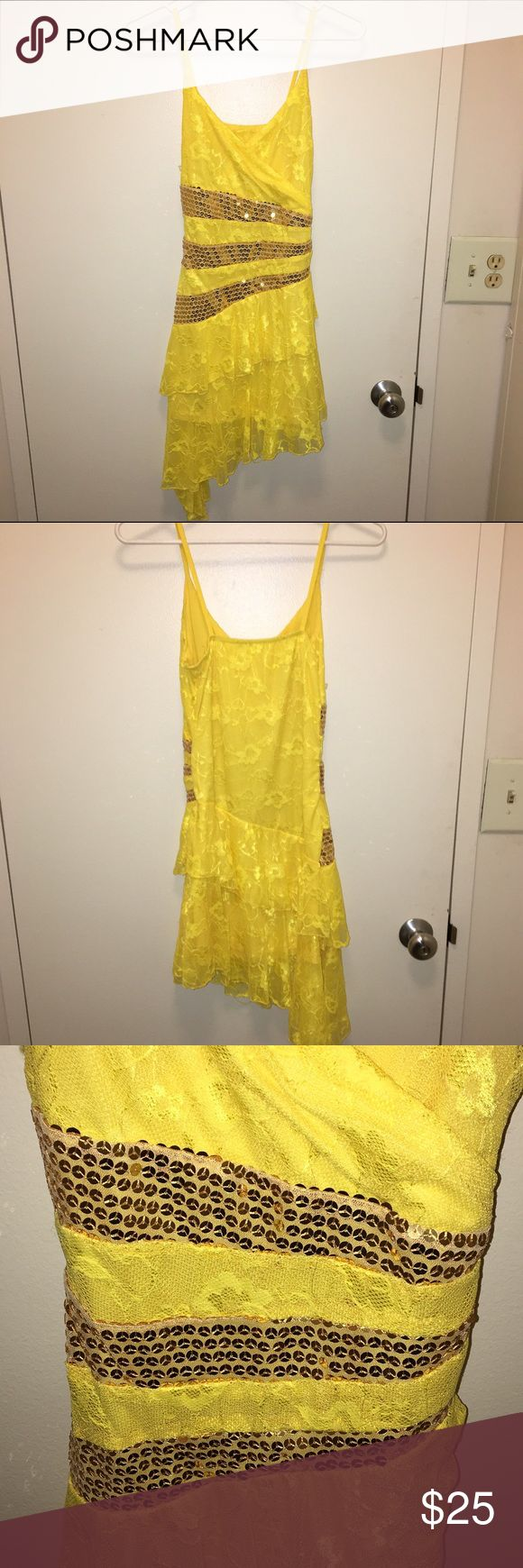 Yellow with gold sequins lace dancing dress disco Yellow lace disco dancing dress. Has gold sparkly sequin accents and a asymmetrical ruffle at the bottom. Spaghetti straps, very stretchy but sized small Dresses Asymmetrical