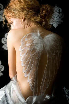 Wings In white. Looks so real. This doesn't look like a tattoo. Wow the realistic shading on that is amazing