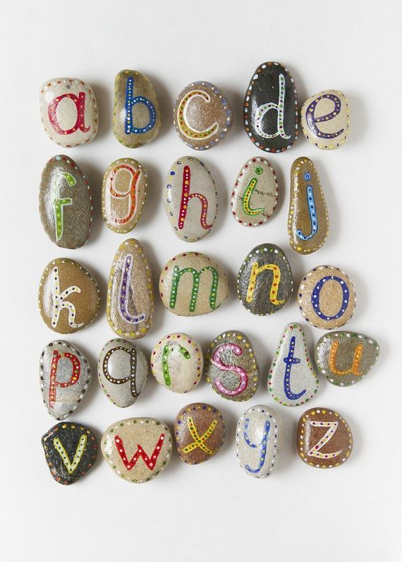 paint letters on rocks for letter recognition. so cute.