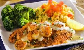 NEW ORLEANS SEAFOOD  Ruby Tuesday Copycat Recipe   Serves  6-8   2 1/2 pounds tilapia fillets   1 cup Alfredo sauce  3/4 lb shrimp, shel...