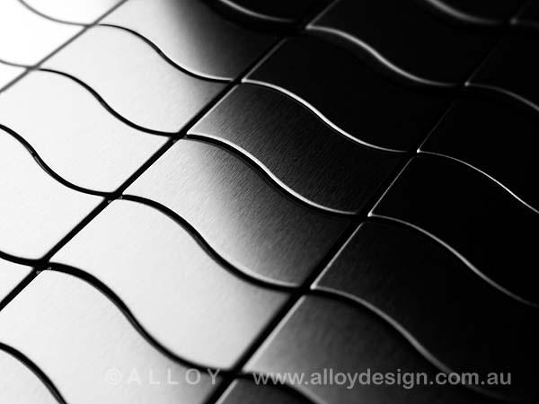 Karim Rashid for ALLOY 'Flux' tile in brushed stainless steel.