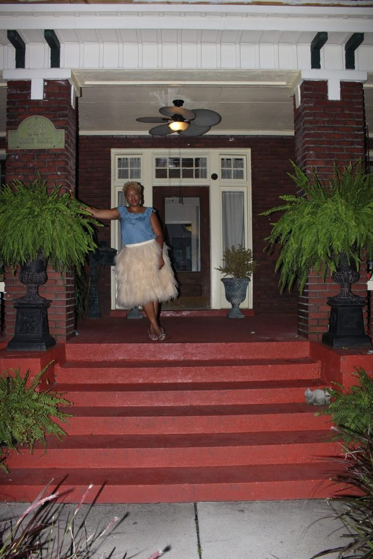 Memphis,TN Home Tour. My southern furniture style is reflected on my front porch. I have two shaker rocking chairs and a porch swing. I also have two huge ferns that adorn each side of my porch entry.