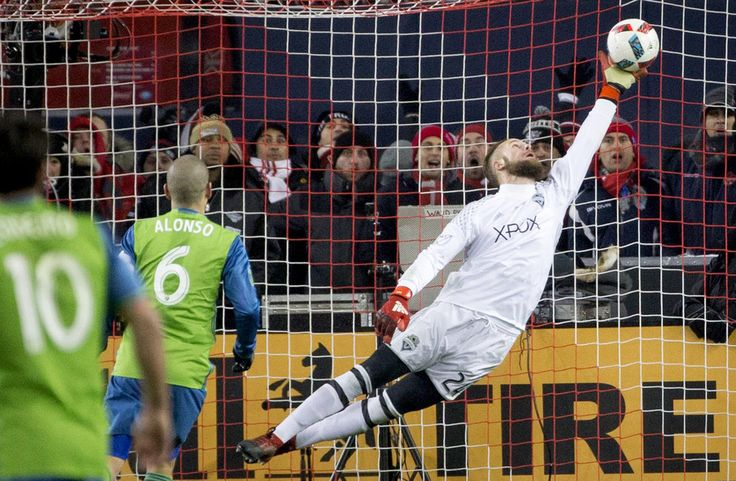 Seattle Sounders goalkeeper Stefan Frei makes a one-handed save on a shot from Toronto FC forward Jozy Altidore to keep the game tied at 0-0 during the MLS Cup. (Lindsey Wasson / The Seattle Times)