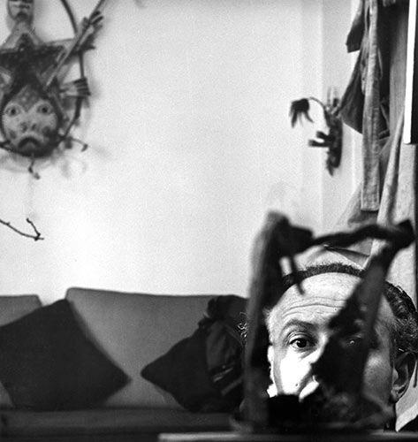 Enrico Donati with Yup'ik mask, c. 1948. Photograph by Tony Vaccaro