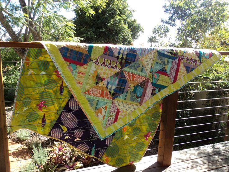My first quilt creation thrown over the rail over the deck that overlooks my other creation ... the garden.