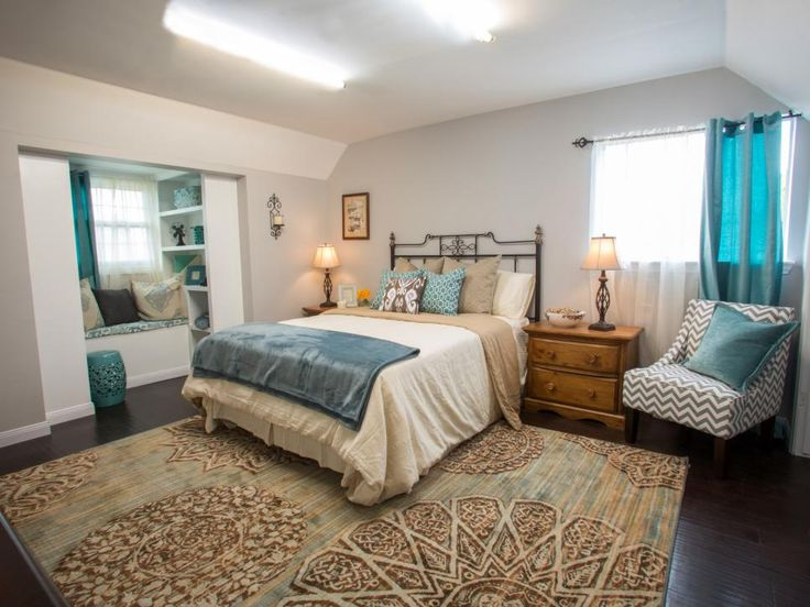 Best A Newly Redone Bedroom Features A Small Reading Area Accented With Calming Teal Shades That Echo 400 x 300