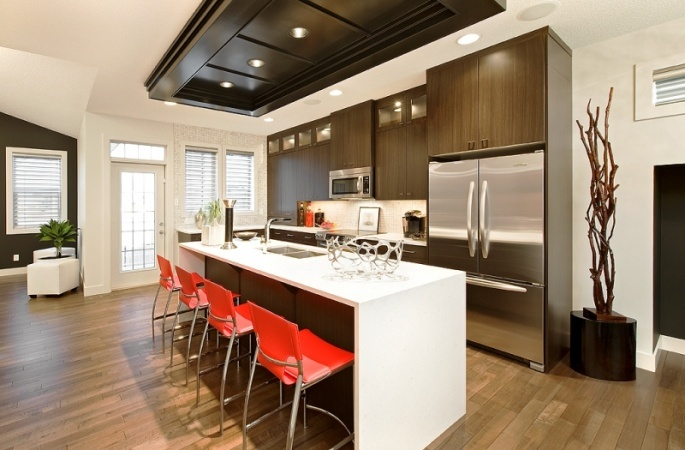 Hillside in Ravenswood by Broadview Homes. Click here for more #decorating & #decor ideas: http://www.broadviewhomes.com/calgary/photo-gallery #kitchen #kitchens #red