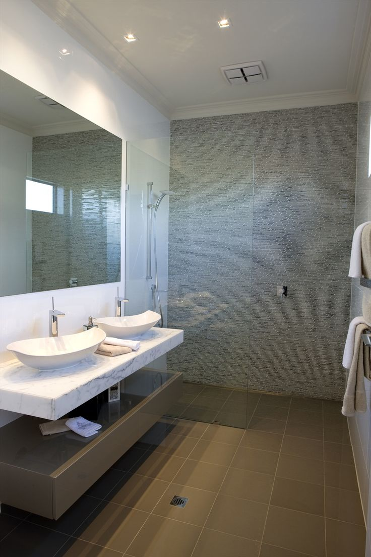 Bathroom Design Idea - frameless, doorless shower, mosaic tile feature wall, white tile walls, stone bench/sink, frameless mirror and warm floor tiles (designer unknown, Beaumont Tiles)