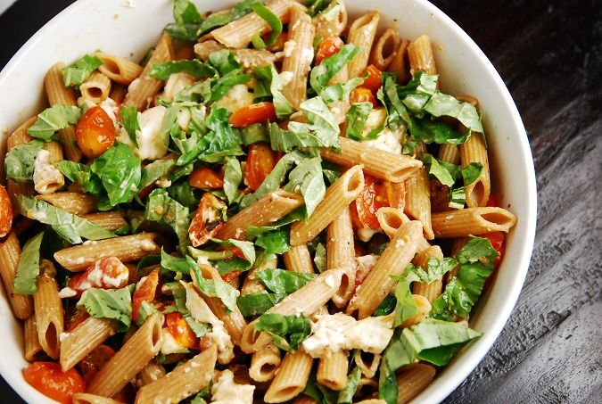 Caprese Pasta Salad Recipe – 6 Points   - LaaLoosh        8 oz whole wheat pasta      1 lb cherry tomatoes, halved      8 oz fresh mozzarella cubes or slices, roughly chopped      5 garlic cloves, chopped      1 cup fresh basil, roughly chopped      3 tbsp balsamic vinegar      1 tbsp olive oil      1 tbsp oregano      Salt and pepper to taste      Read more: http://www.laaloosh.com/2013/05/28/caprese-pasta-salad-recipe/#ixzz2UpgQlGRj