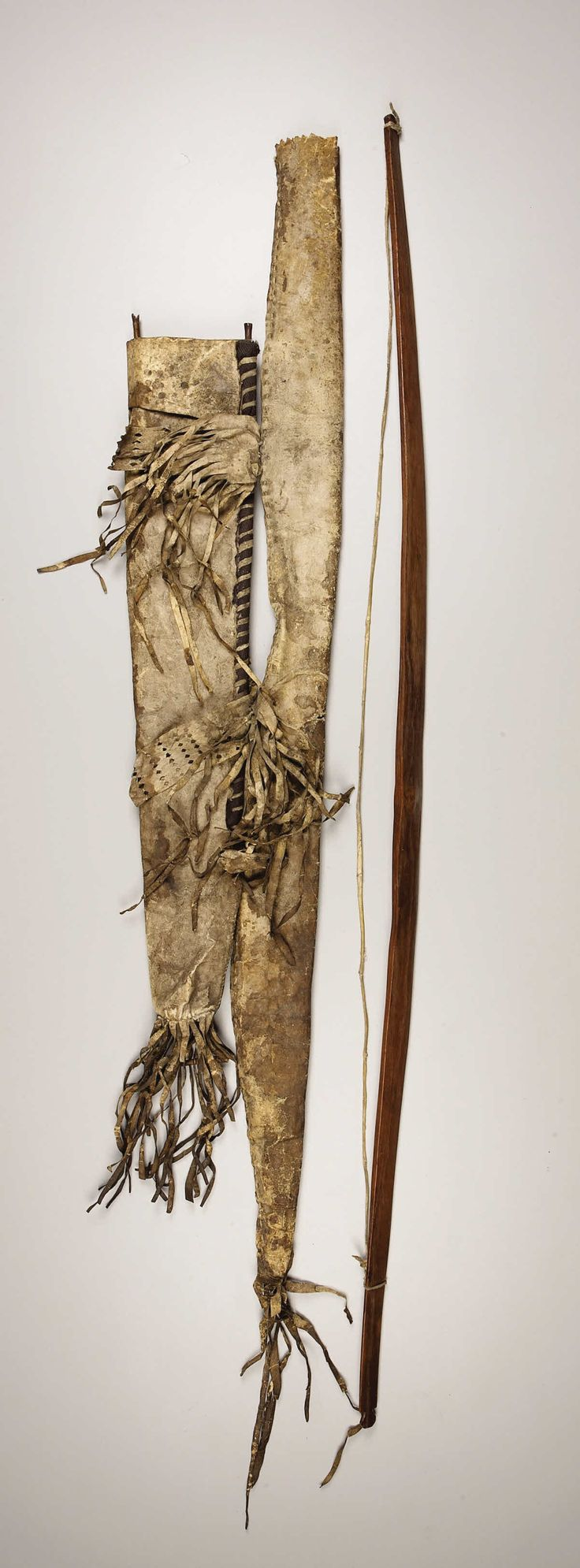 AN APACHE HIDE BOW CASE AND QUIVER. . c. 1880. ... American Indian | Lot #77040 | Heritage Auctions