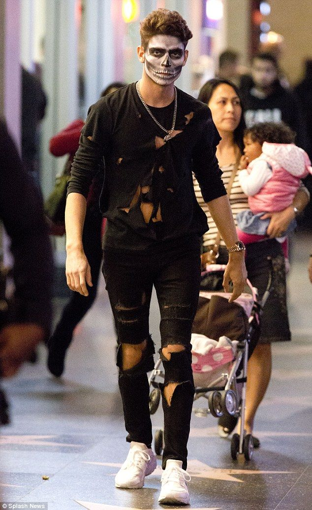 Here he comes: Joey Essex strolls the Hollywood Walk Of Fame after dressing for Halloween on Friday evening