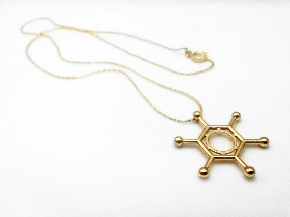 READY TO SHIP Hexachlorobenzene (Gold-Plated Brass) Chemistry Molecule Necklace   Brass pendant of hexachlorobenzene electroplated in gold. Why hexachlorobenzene? Because this was the molecule whose structure a prominent female scientist, Kathleen Lonsdale, determined by x-ray diffraction, which confirmed that benzene was a flat molecule. Also, it showed benzene having bonds of equal length, which gave way to the concept of resonance. Atoms and bond lengths are not made to scale!